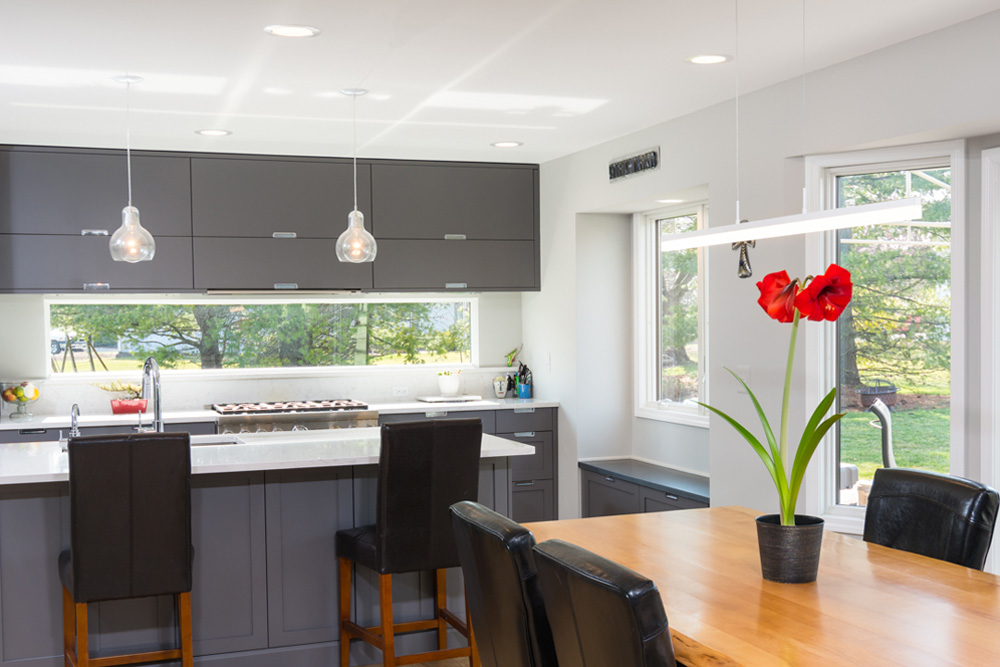 contemporary kitchen renovation with painted gray cabinetry