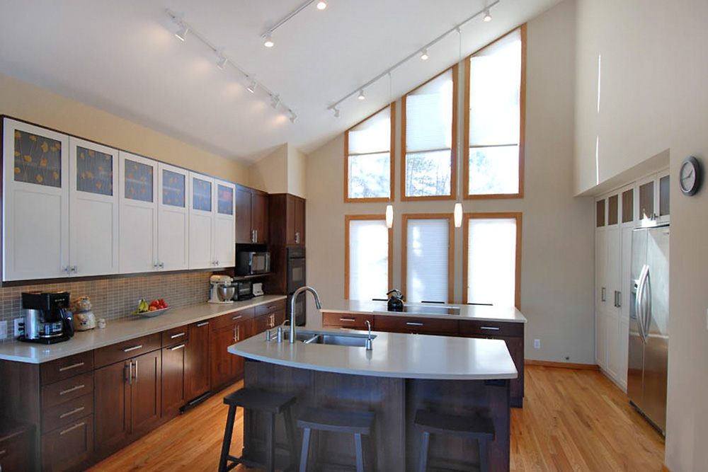 Vaulted ceiling kitchen remodel with extensive lighting