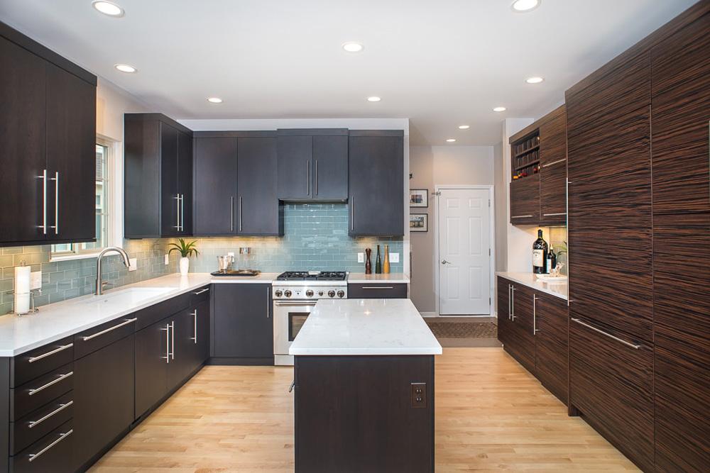 White Quartz Countertop and Dark Cabinet Kitchen