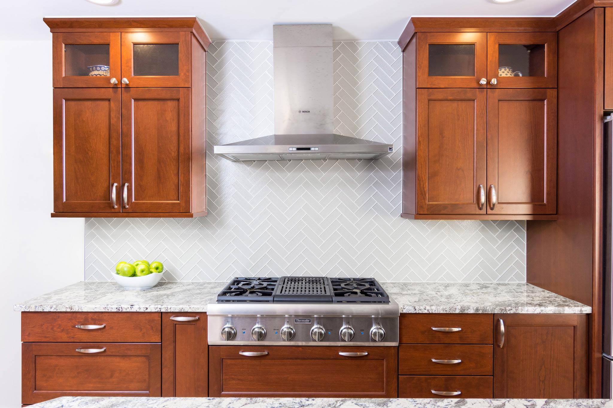 shaker-cabinets-and-glass-tile-backsplash-herringbone.jpg
