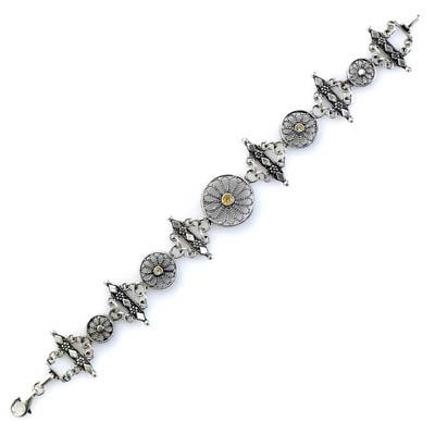 Silver floral filigree bracelet with stones