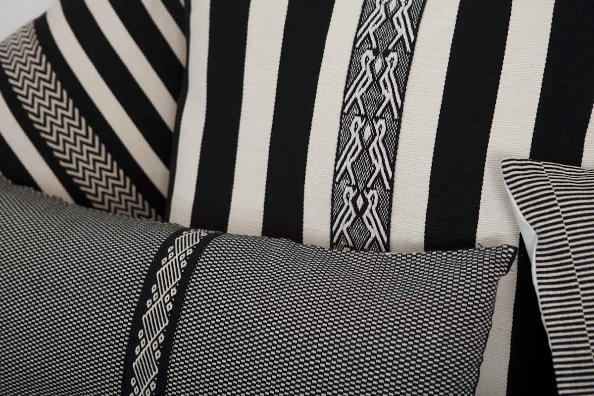 Woven pillow covers by País Textil