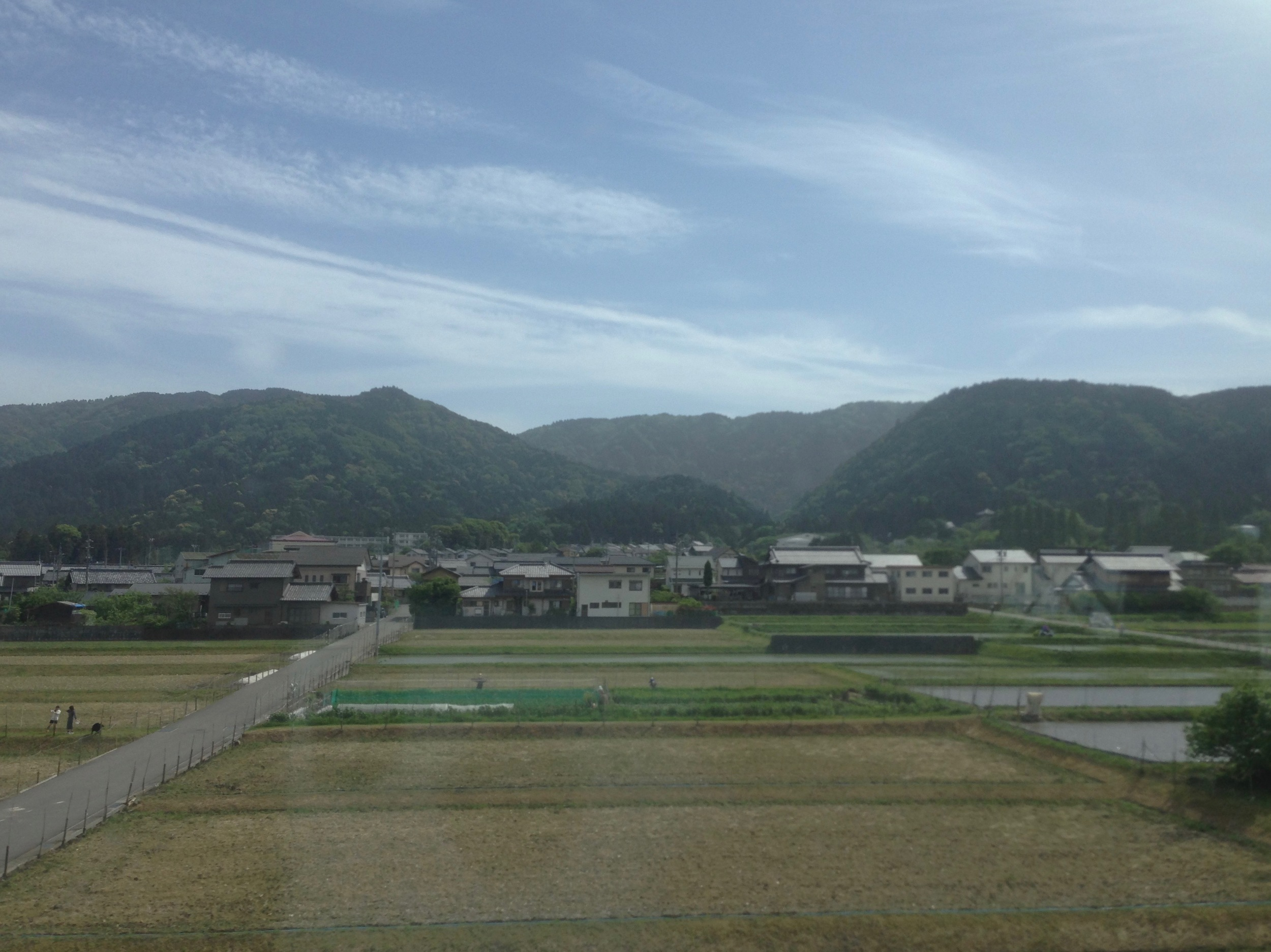 View from the Shinkansen of Japanese towns.