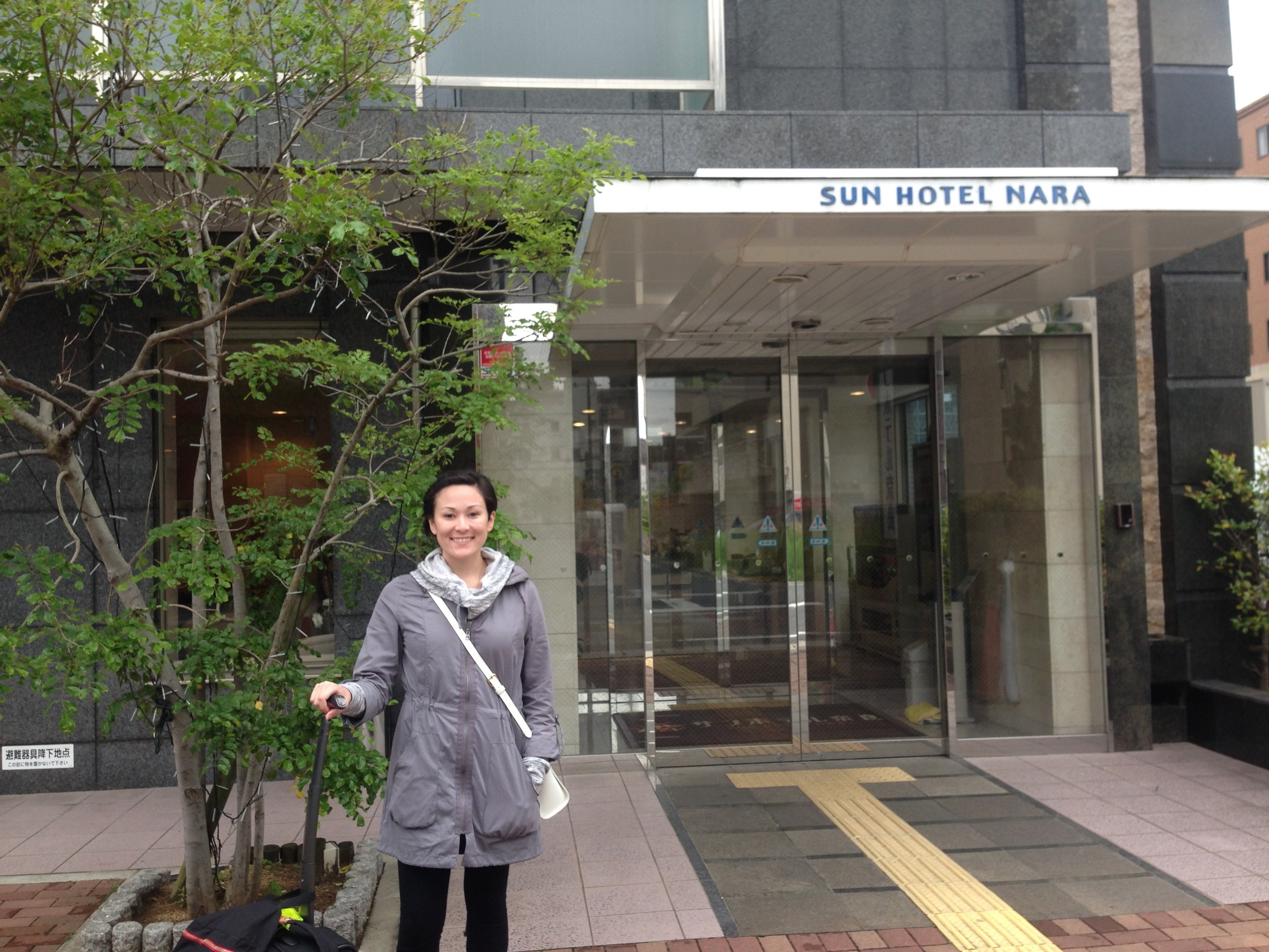 Standing in front of our Sun Hotel!
