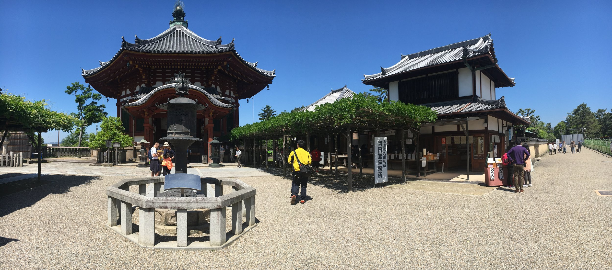 The pavilion with temples, shrines, and shop. Buddhist on the left.