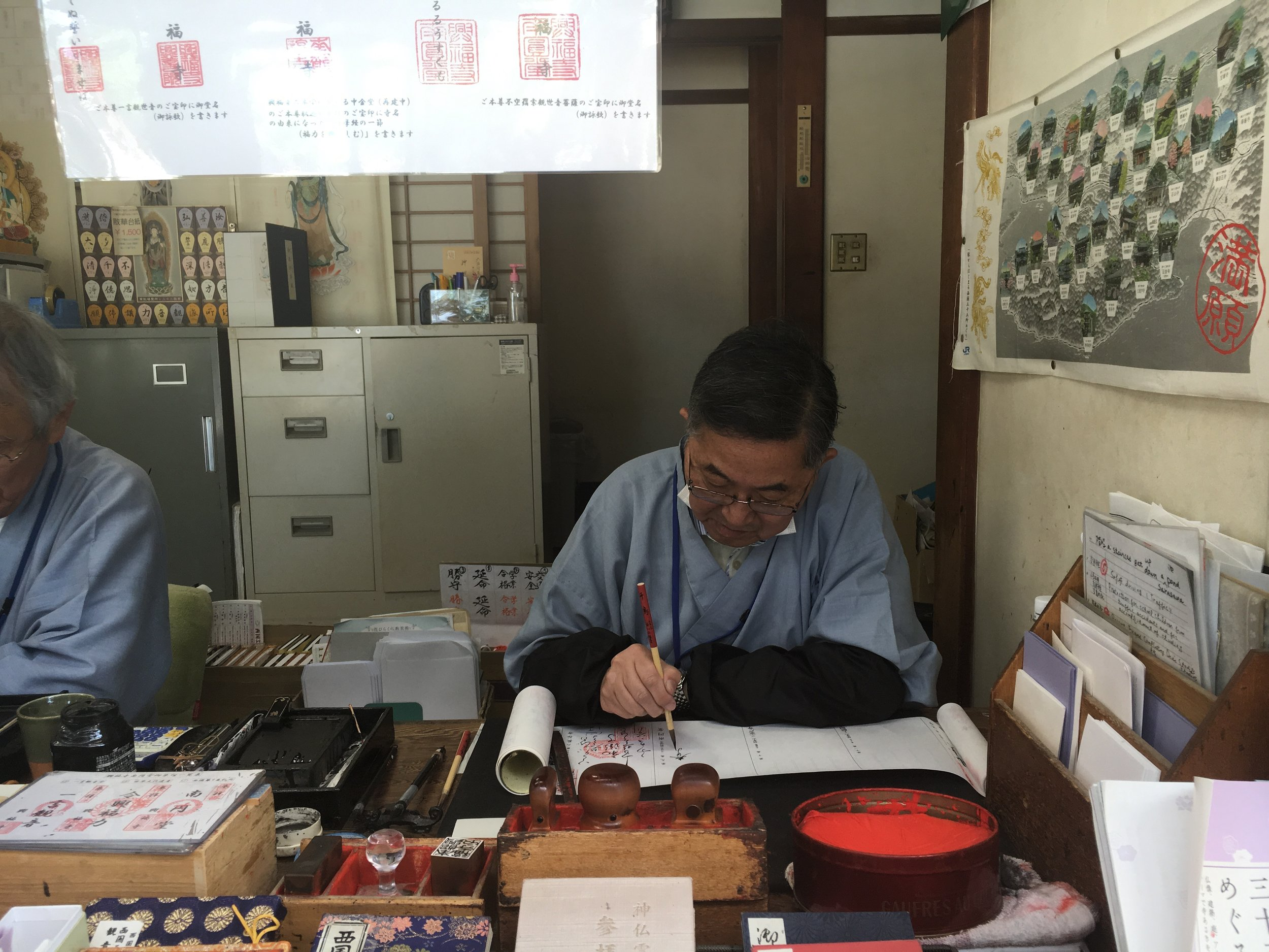 A Monk who signed our book we purchased at the store. The stamp and calligraphy were simply beautiful.