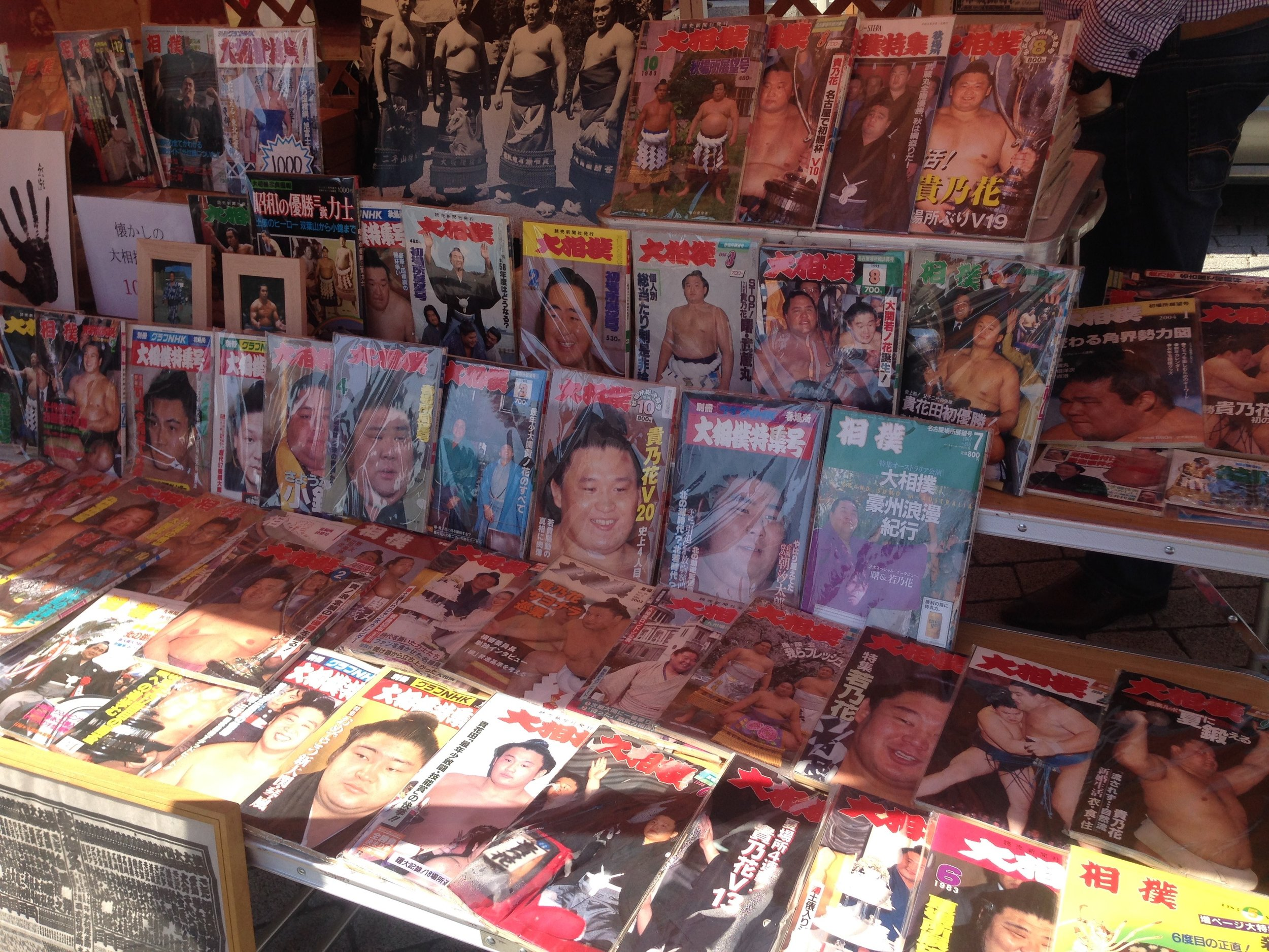 Sumo magazines for sale outside the stadium.