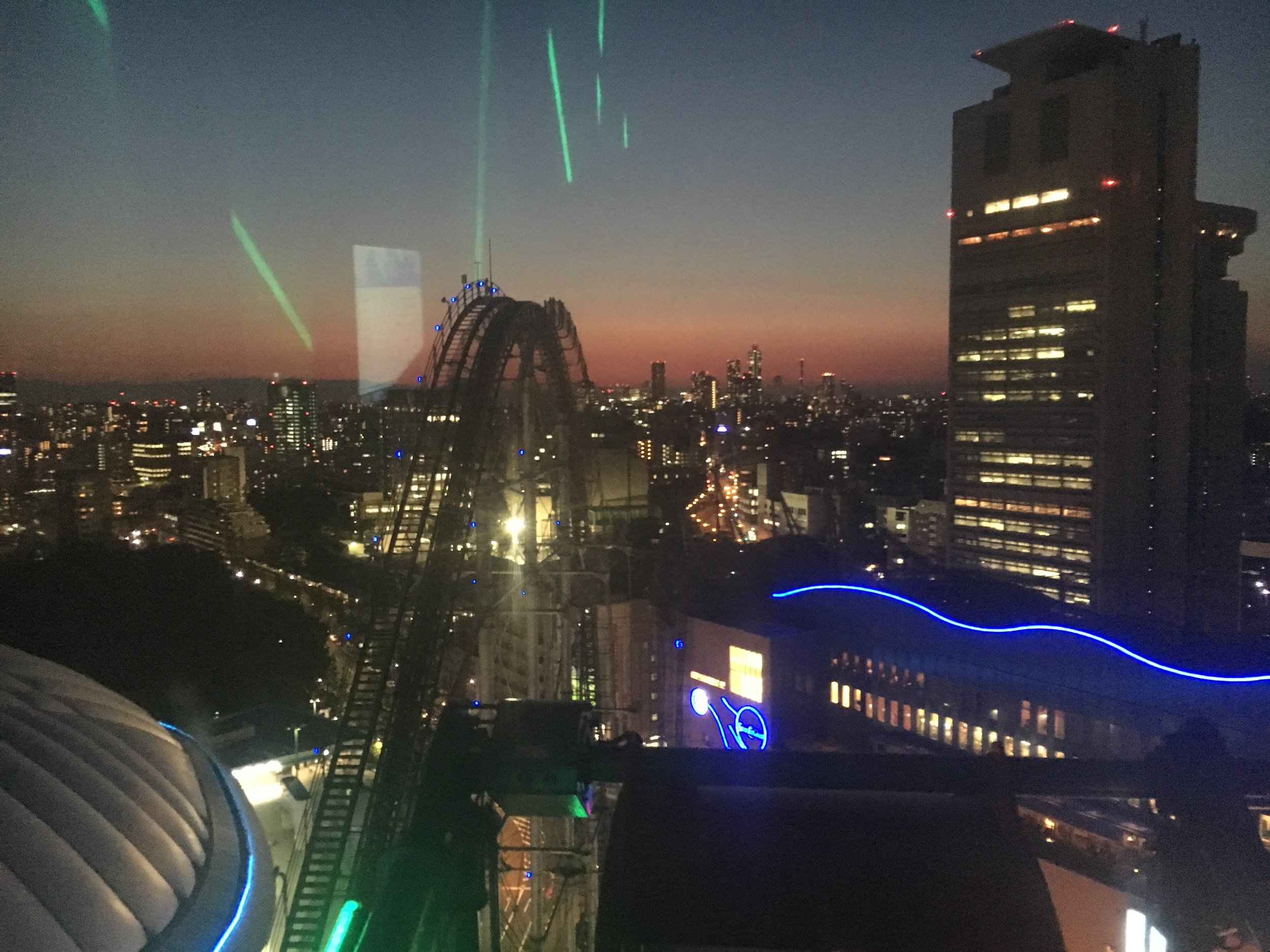 Final views of the roller coaster and Tokyo Tower way in the distance. (The next tallest building to the left of the rig one one the right, looks like a needle.)