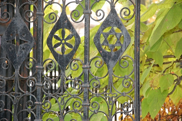 Be sure to examine the exquisite iron fence surrounding the garden.