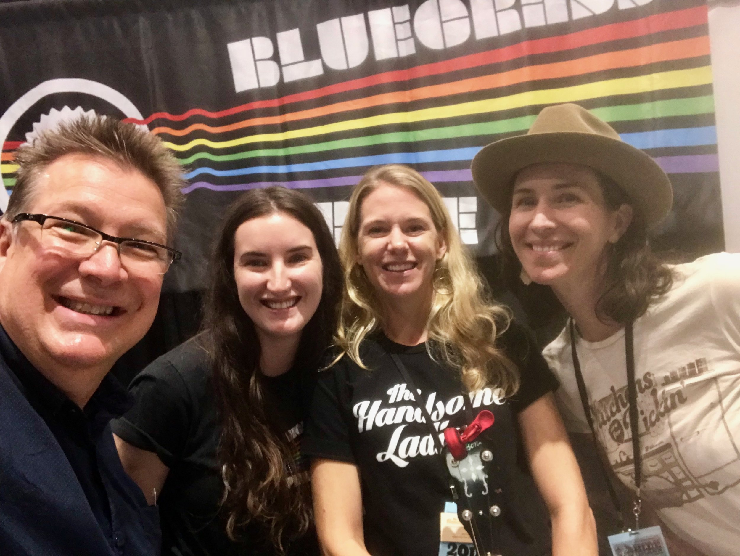 Banjo Player of the Year (and my banjo teacher) Ned Luberecki stops by our booth, Kara Kundert, me, Gina Astesana