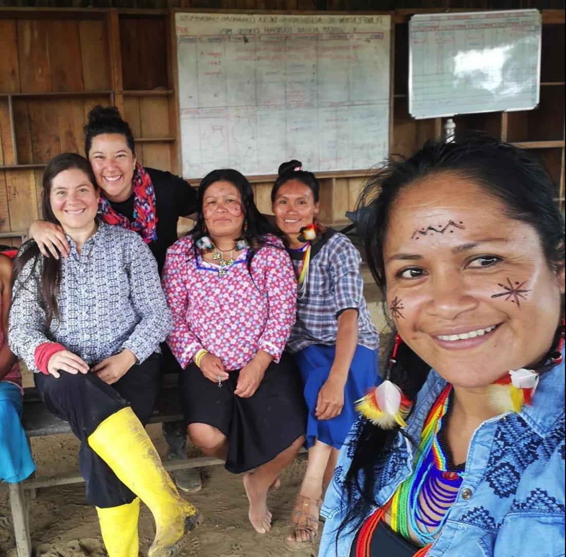Narcisa Mashienta (far right), leader of the Ikiama Nukuri initiative, shown leading a community workshop.