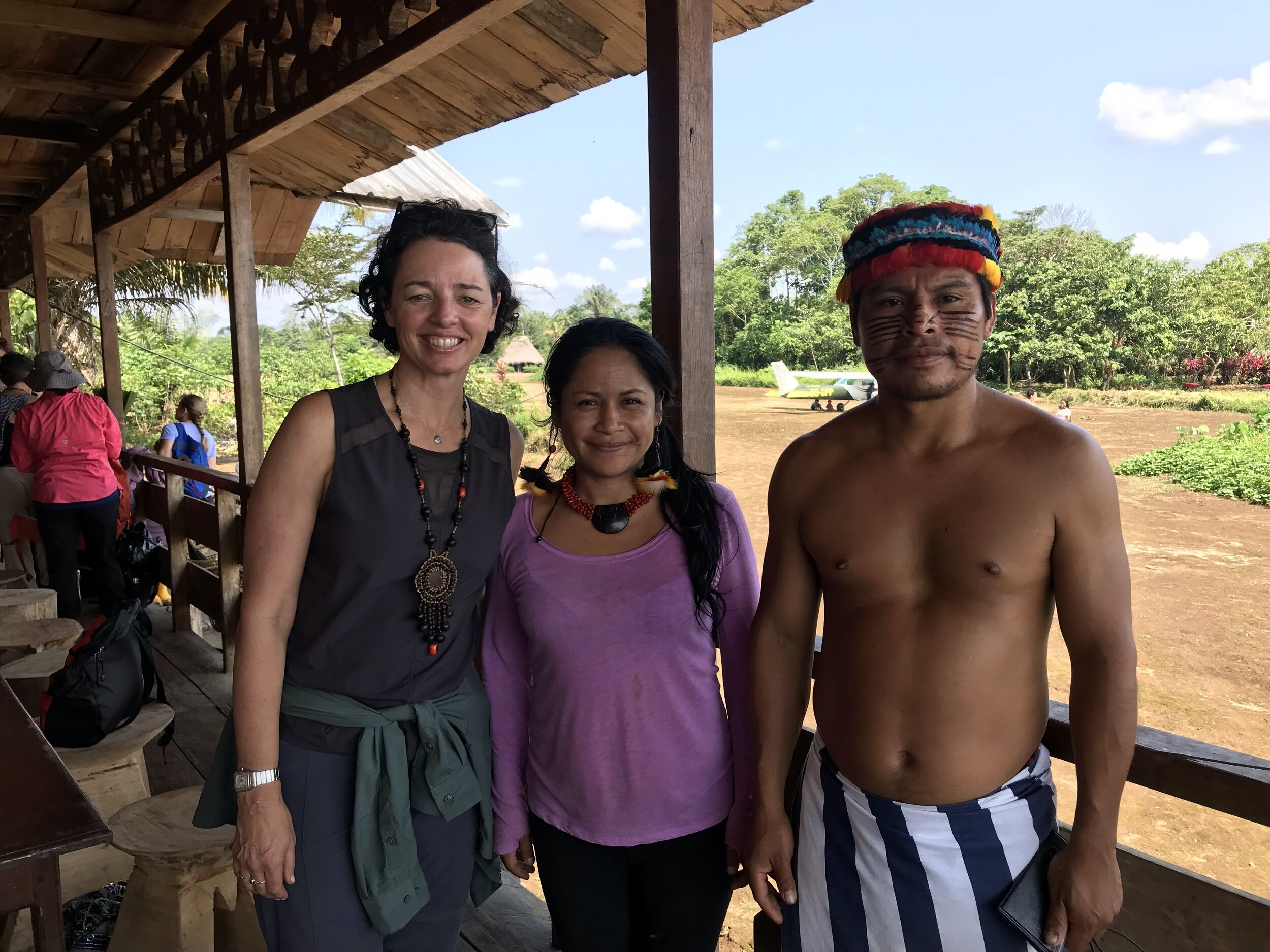 Grace Kraaijvanger, Founder of The Hivery, Narcisa Mashienta, leader of Ikiama Nukuri, and Marco Mukuink of the Sharamentza community, meeting on the recent Hivery and Pachamama Alliance journey to the Amazon.