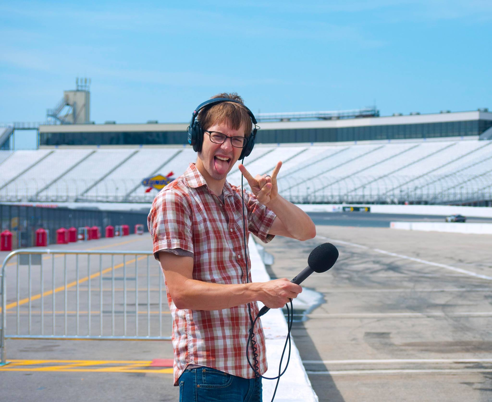 Producer Taylor Quimby records audio for a story at the Loudon Speedway
