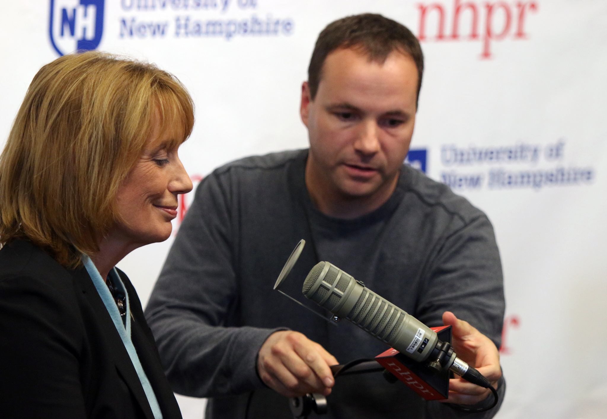 Governor Maggie Hassan gets a sound check before a live conversation with Laura Knoy at the Rudman Center, 2014