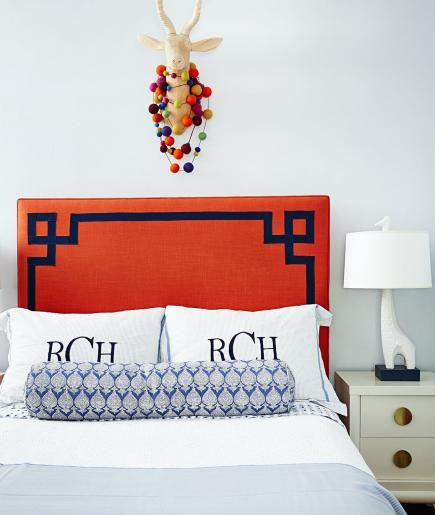 I'm loving the accent trim on the headboard with the  jonathan adler  giraffe lamp. via  midwest living