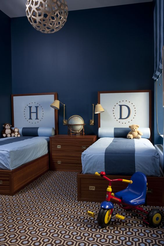i'm not sure what i love most about this boy's room,the headboards, campaign style beds, the campaign nightstand, or the carpet!!