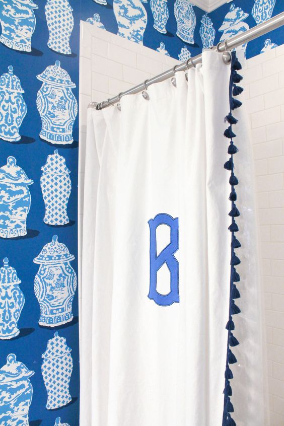 i love a monogrammed  shower curtain  in a child's bathroom