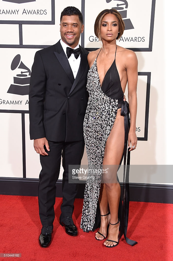 Ciara and her boyfriend Russell Wilson. The grammys are one place where you can show some skin and get away with it. Well, she's showing a lot of skin and rocking it!! And props to her double sided tape, it's working wonders!