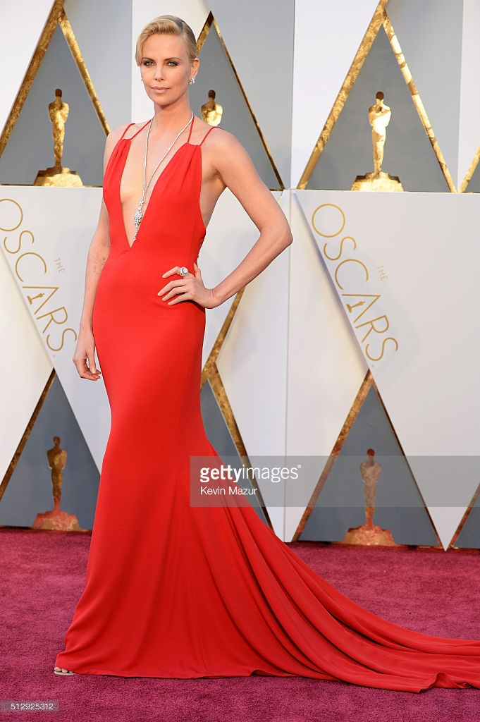 charlize theron wearing christian dior.  Her film mad max: fury road won so many awards.  just one more to add to the movie night list
