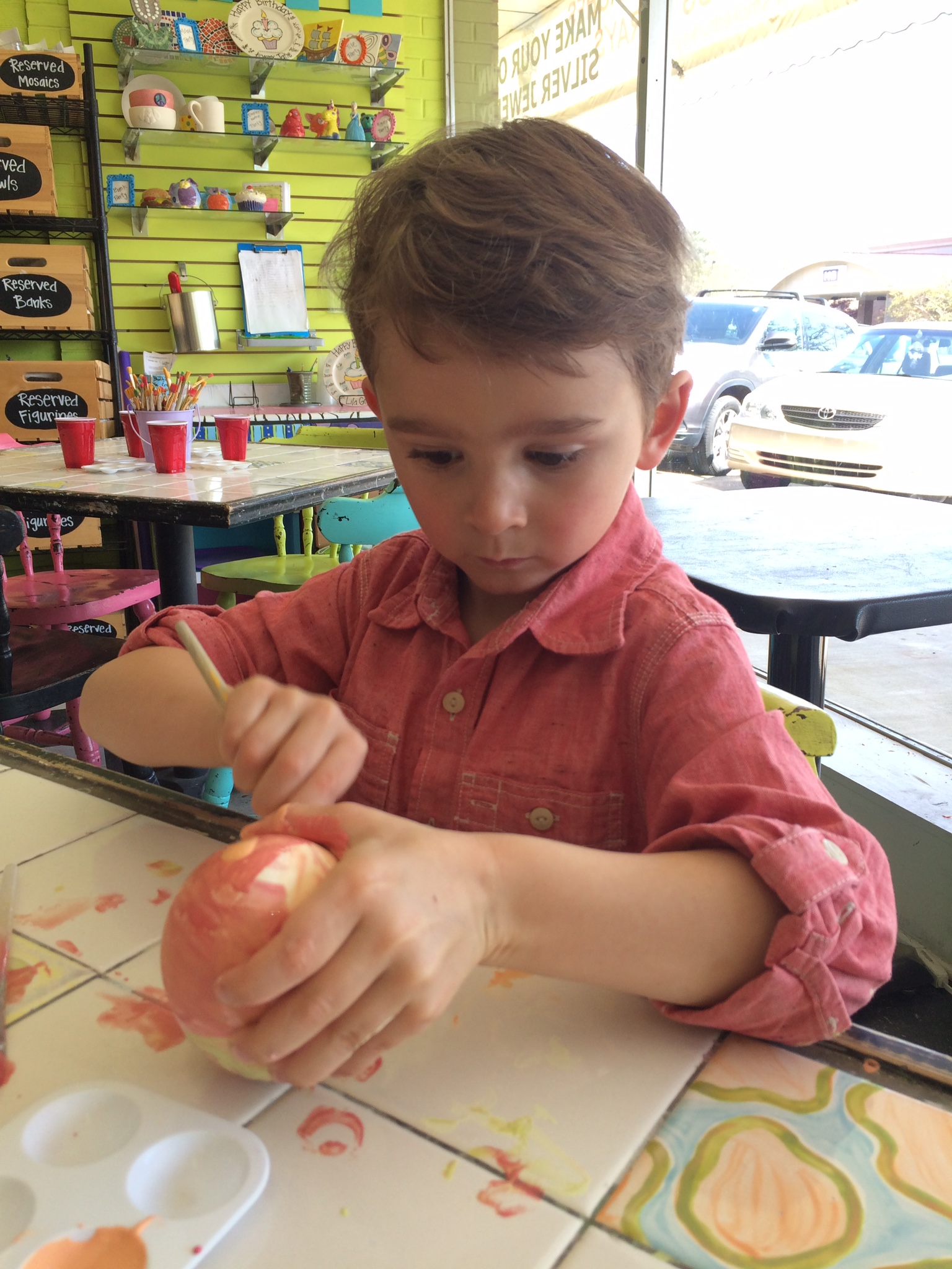 painting dinosaur eggs at the painted pig