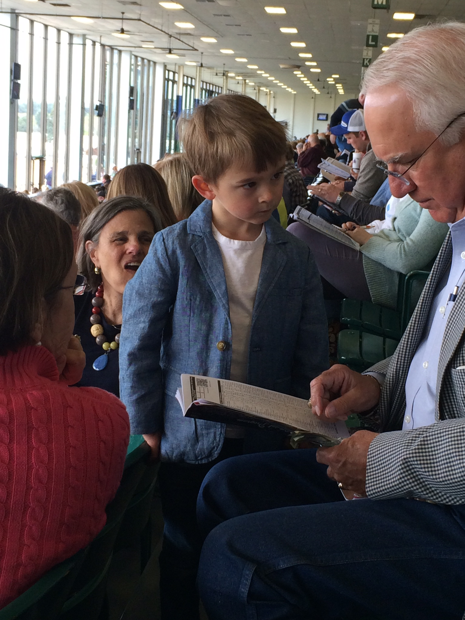 I'm just sayin', there's a chance asher might become a bookie when he grows up.  he was even approaching people he didn't know asking who they were betting on.