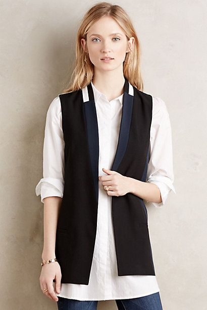 this  vest  looks way better than how it's shown here.  I plan on pairing it with the blouse below.  By wearing it with a shirt shorter than the vest, the vest is able to take center stage.  As it should, it's tailored to perfection and is very unique