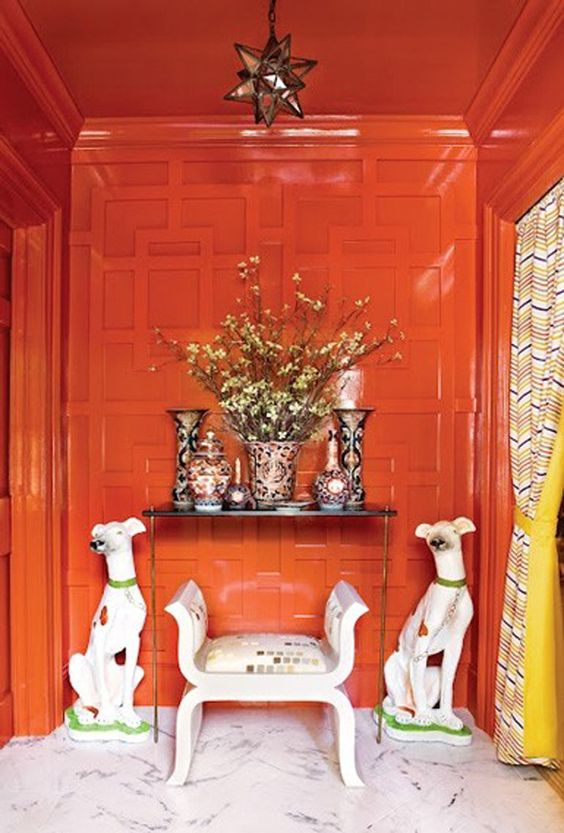 This takes lacquering a wall to a whole other level by painting out the millwork and crown moulding