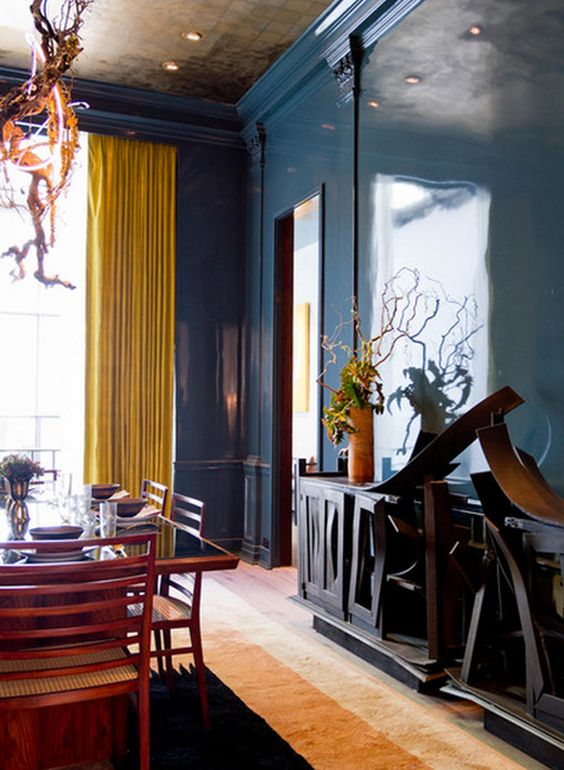 another unique blue room. Note the drapery color, it's gaining more and more popularity lately in decor