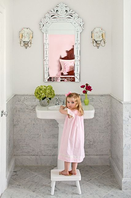 note the coordinating sconces with the mirror?  Oh and that adorable little girl.  that's how i would dress my little girl, but with a bow the size of texas.
