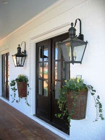 loving the mounted planters and lanterns