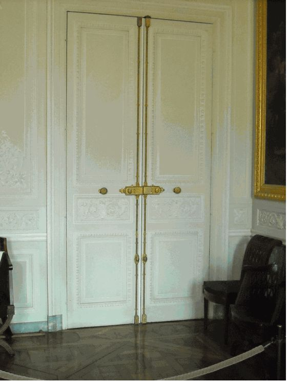 just look at all that moulding paired with the gold  cremone bolts .  Marie Antionette had great taste.
