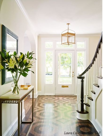 Not quite ready to paint your floors? Try a two tone stain for a more subtle approach.  Via
