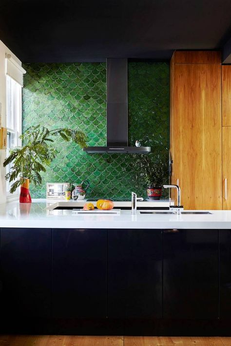 The  fish scale tiles  are becoming more and more popular and in this malachite green it really makes a large impact.