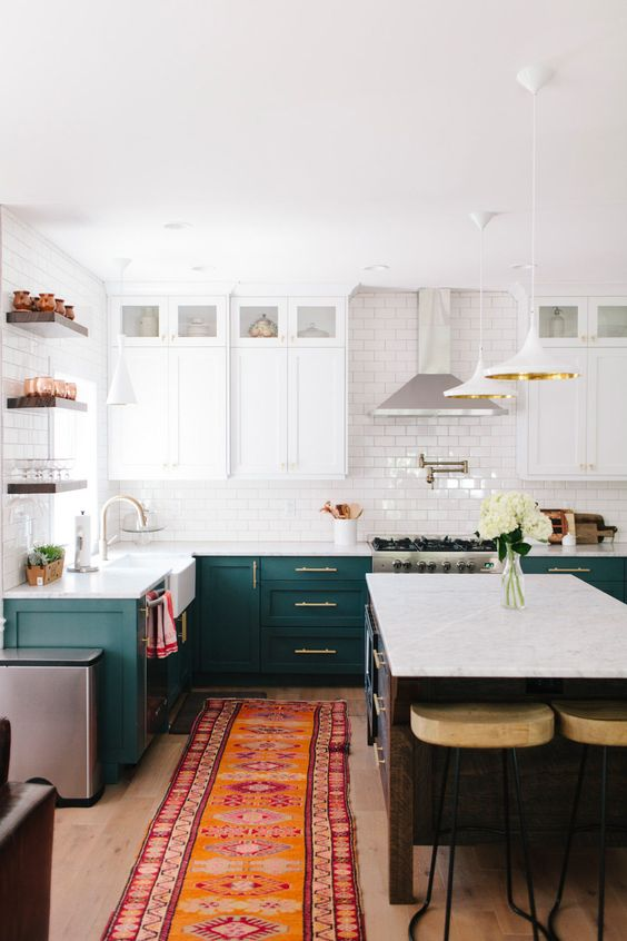 The base cabinets and rugs in this  kitchen  bounce their colors off each other, and highlight each other.