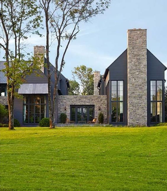 A modern take on a  traditional farm house  situated on an old civil war site in nashville, tennessee.  I PARTICULARLY like the mix of the metal awning with the stone and black.