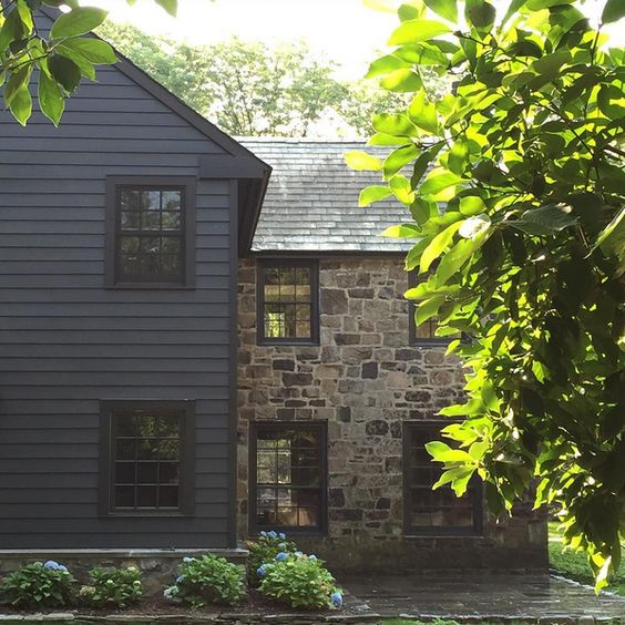 This stone gives me the feel of an old english cottage combined with the worn wood shingles.