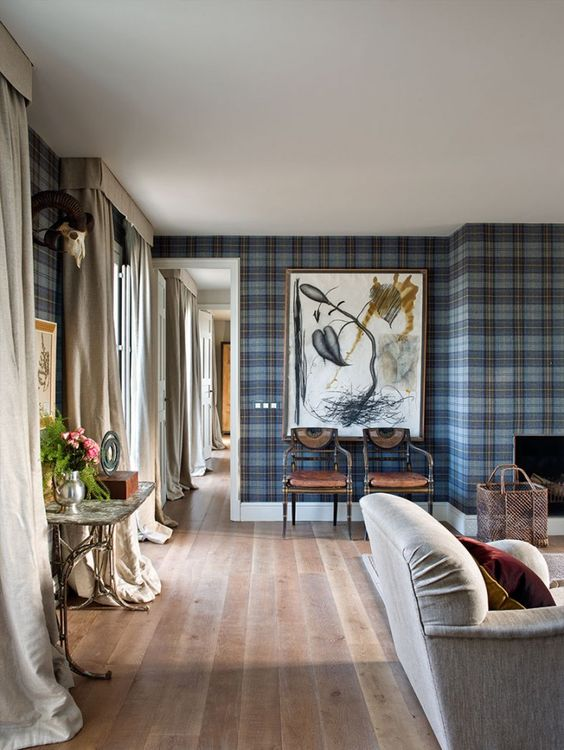 This is such a  soothing space , yet has such a punch with the tartan wallpaper.