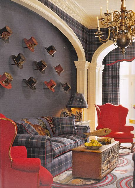 Oh my heavens I'm over the moon for this space. Between those top hats, that sofa with matching cornices and those candy apple red wing chairs. This would be the cutest little boy nursery.
