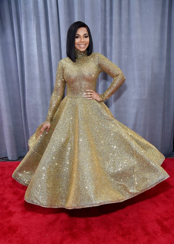 Ashanti arrived in a Yas Couture by elie madi gold, wavy, full gown.  It didn't hold up to the camera's flash so well but it's still a special look.