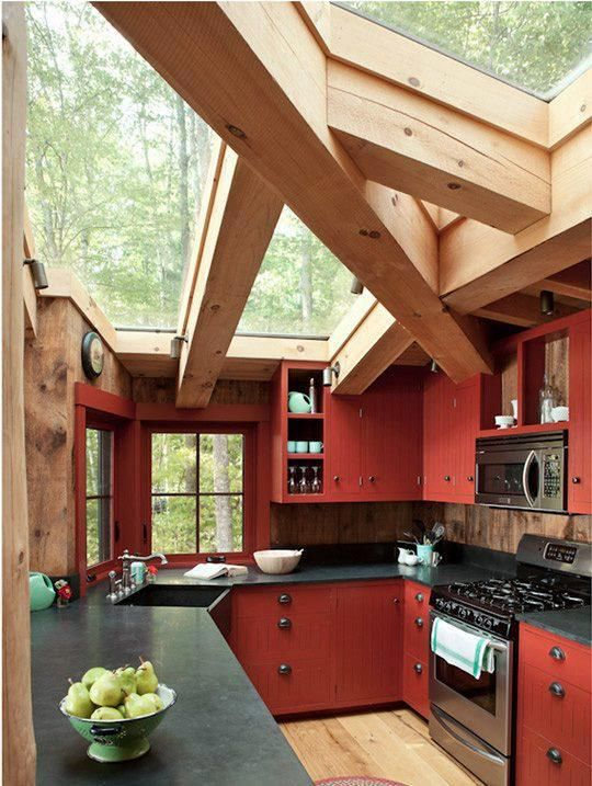 I see red walls in kitchens often.  I think people who paint their kitchens red think it makes their kitchen look more regal but in actuality, is it's doing the opposite.  I think rust red cabinets could work in a mountain home like the one above.  But again, for your everyday kitchen, DON'T PAINT YOUR WALLS RED!!