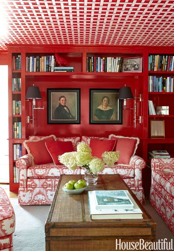 a prime example of how you don't have to paint your entire room from floor to ceiling red, but by breaking up the red with white for the ceiling, still lends itself to a bright  room .