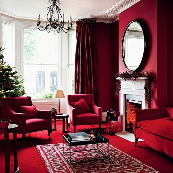 oh, oh, oh, this is my favorite red room.  And what's crazy is it even has red carpet and I'm still on board.  I love all the different shades of red from, burgundy red, to ruby red, to purple - red.  The light from the windows and mirror really help bounce all the colors around.
