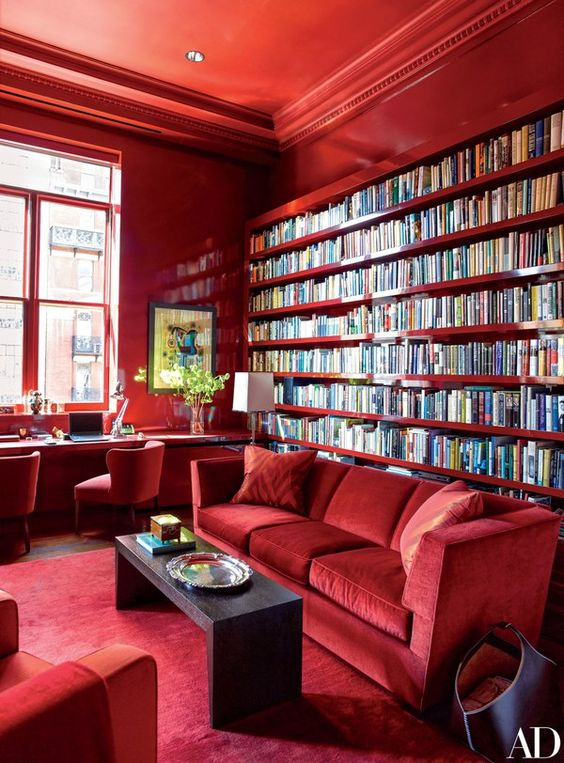 this was a former athletic club in New York, turned high style manhattan apartment with a very large, dramatic  library.