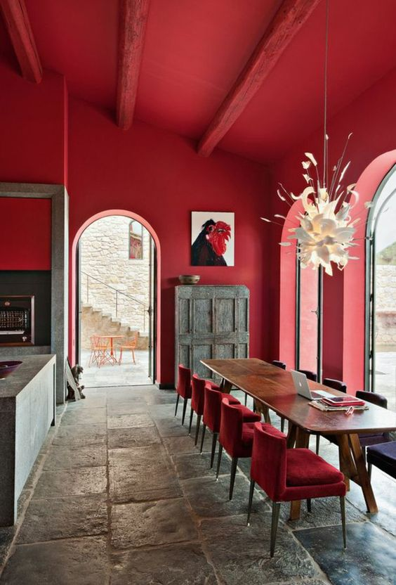 What a great COMBINATION; rustic, contemporary, and bold.  I'll tell you, it's those large doors, that make this room work.  It feels breezy and light, while being covered top to bottom in cherry red.