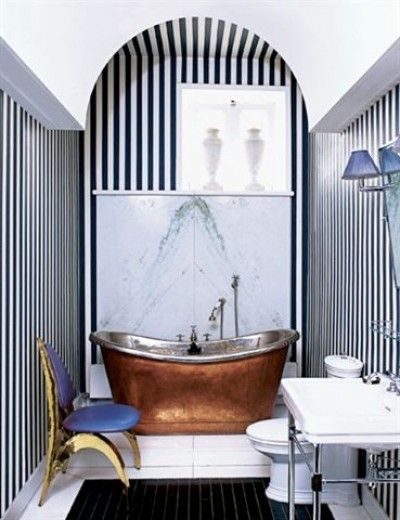 """Oh my goodness. You've got art deco mixed with this """"rustic"""" copper tub for a special little retreat."""