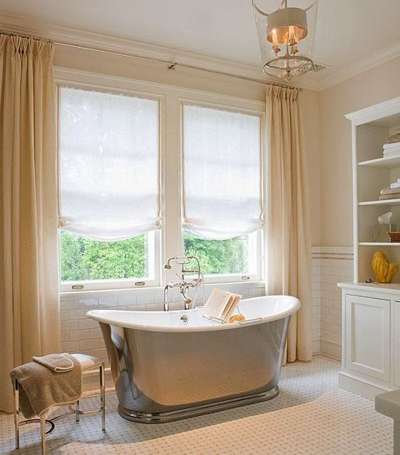 I AM IN LOVE WITH THIS TRADITIONAL BATHROOM WITH THE SHEER SHADES, LIGHT FIXTURE, AND BASKETWEAVE TILE.  AND OF COURSE THE TUB WITH BOOK HOLDER.