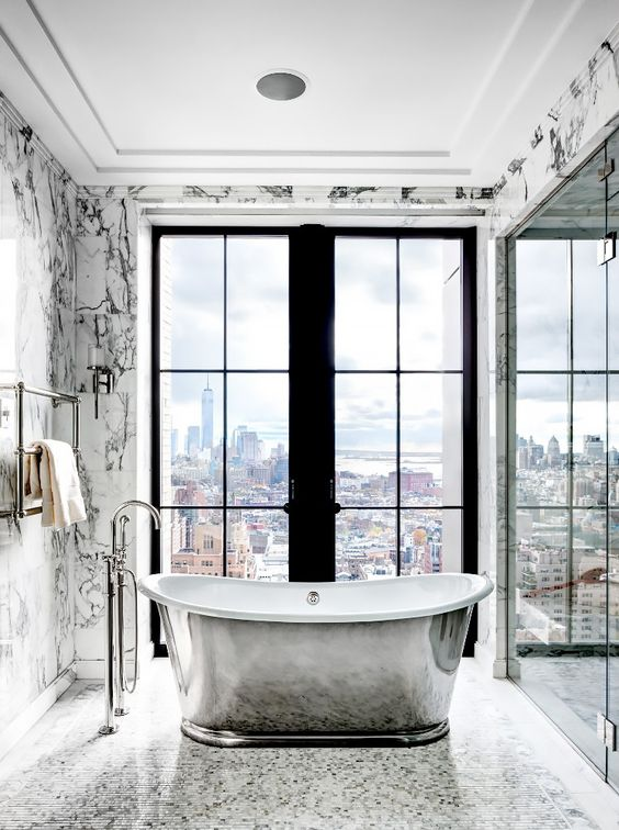 holy bathroom and view!!!  Can you even imagine sitting in this tub at night looking at all the city lights?  I would just about die if this was my bathroom.  Via  My Domaine