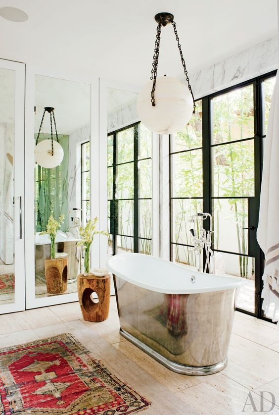 Fashion Designer Jenni Kayne's 1980s home got quite the transformation with this  Waterworks tub .  Via  Architectural Digest