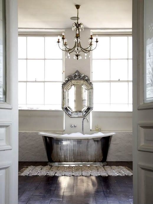 There's a lot of shiny going on in this bathroom, but because it's all simple, it works.