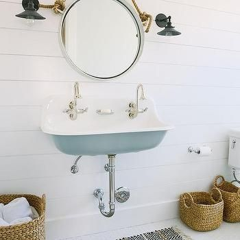 another subtle nautical bathroom. I'm really digging the rope mirror and lights.